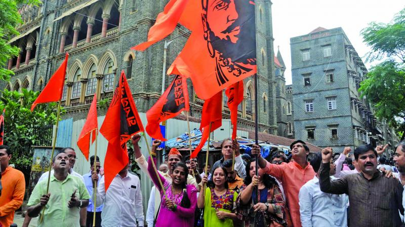 In this file photo, Maratha activists celebrate the reservation verdict passed by the Mumbai high court on Thursday in Mumbai. —Shripad Naik