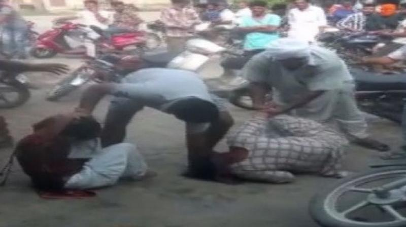 A video of the incident, that has now gone viral on social media, shows a group of men brutally thrashing two women and hurling abuses at them. (Photo: ANI)