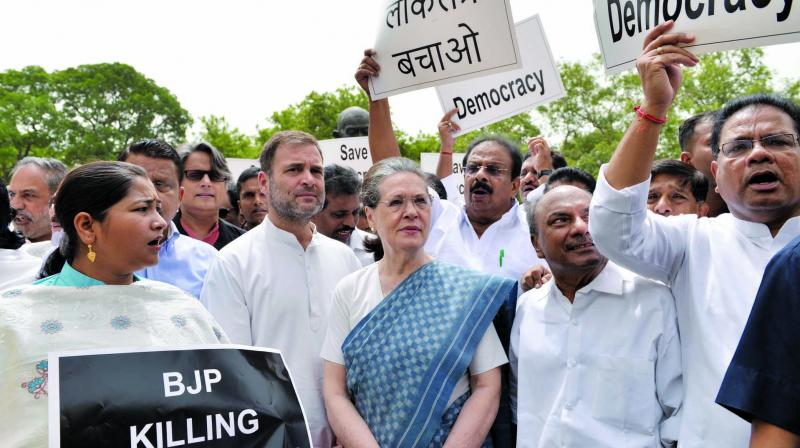 Congress leaders Rahul Gandhi, Sonia Gandhi and A.K. Antony during a protest  at the Parliament in New Delhi during the Budget Session on Thursday. (Photo: Asian Age)ASIAN AGE