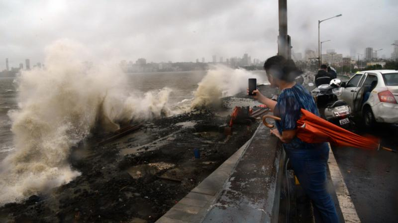 A girl takes a selfie of the huge tides at the Marine drive in Mumbai. — Rajesh Jadhav