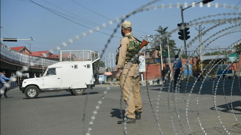 CRPF vehicles stationed at Lal Chowk on the first day of the two-day curfew in Srinagar. PTI photo