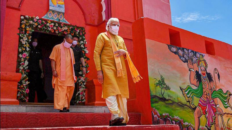 PM Narendra Modi visits Hanumangarhi in Ayodhya. He is accompanied by UP chief minister Yogi Adityanth after the Ram mandir Bhumi Pujan in Ayodhya. PTI photo