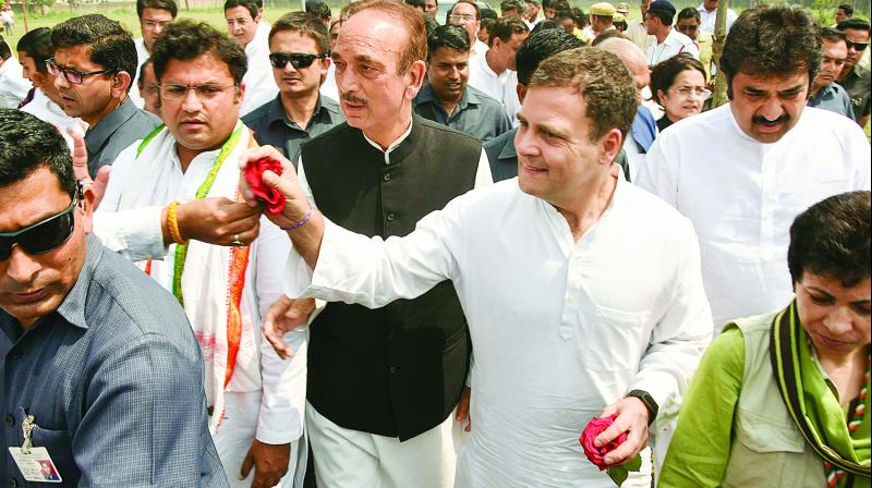 Congress president Rahul Gandhi and senior Congress leader Ghulam Nabi Azad during the campaigning in Yamunanagar on   Friday. 	(Photo: PTI)