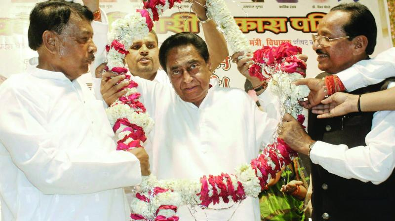 Madhya Pradesh CM Kamal Nath is garlanded at a  convention by tribal leaders in Bhopal. (Photo: PTI)