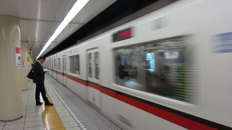 Workers still cram onto commuter trains—albeit in smaller numbers—and Japan's parliament is hardly setting the tone for working from home, continuing to hold sessions and ministerial press conferences. (Representative Image)