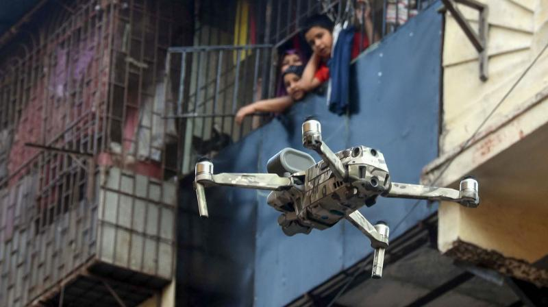 Police uses a drone to check people's movement during a 21-day nationwide lockdown, a measure to prevent the spread of coronavirus, at a market in Mumbai. PTI