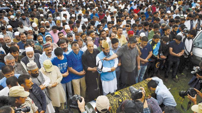 People offer funeral prayers of veteran journalist Shujaat Bukhari at Kreeri in Baramulla district of north Kashmir. Bukhari and his two PSOs were shot dead by gunmen soon after he boarded his car from his office in Press Enclave in Lal Chowk on Thursday. (Photo: PTI )