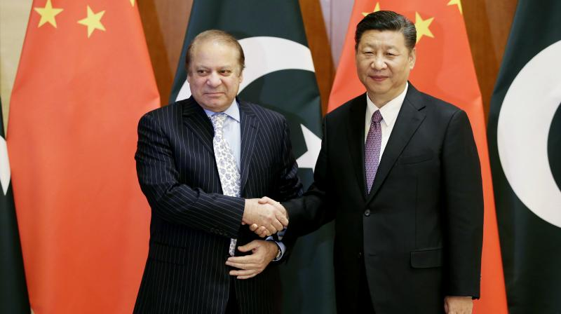 Pakistan Prime Minister Nawaz Sharif, left, shakes hands with Chinese President Xi Jinping ahead of the Belt and Road Forum in Beijing. (Photo: AP)