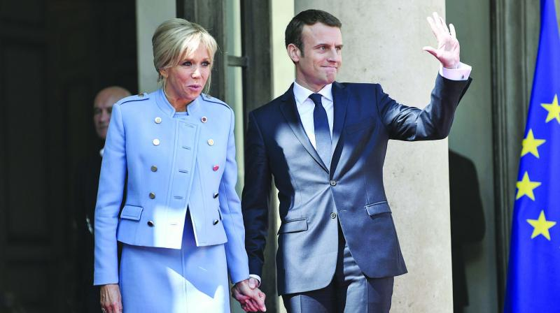 Newly-elected French President Emmanuel Macron poses with his wife Brigitte Trogneux at the Elysee presidential Palace in France on Sunday prior to the inauguration ceremony. (Photo: AFP)