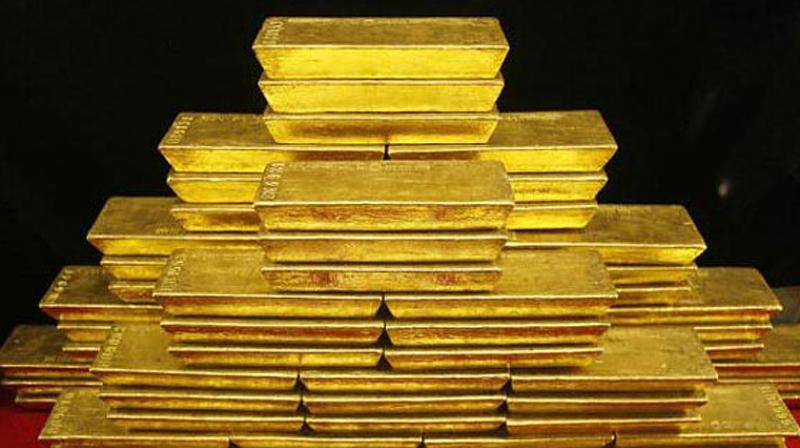 Globally, gold fell by 0.17 per cent to USD 1,198.80 an ounce and silver by 0.52 per cent to USD 14.43 an ounce in Singapore. (Photo: PTI)