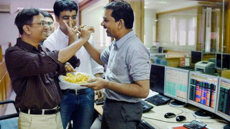 Brokers celebrate as Sensex soared over 250 points on Monday. (Photo: File/PTI)