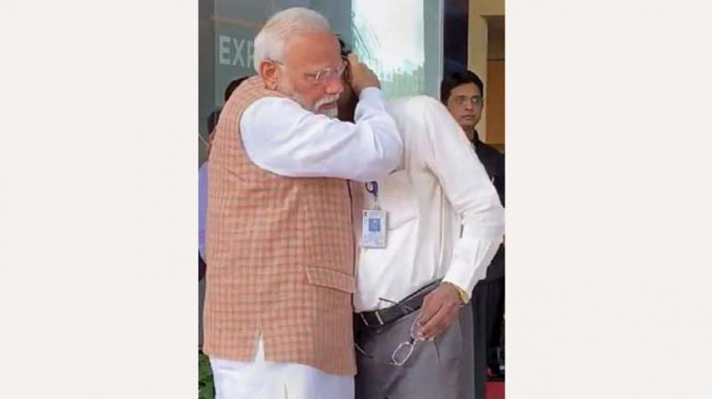 Prime Minister Narendra Modi consoles Isro chairman K. Sivan in Bengaluru on Saturday. 	(Photo: PTI)