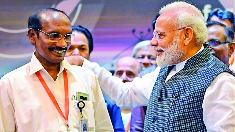 Prime Minister Narendra Modi interacts with ISRO Chairman Kailasavadivoo Sivan after connection with the Vikram lander was lost during soft landing of Chandrayaan 2 on lunar surface, in Bengaluru on Saturday. (Photo: PTI)
