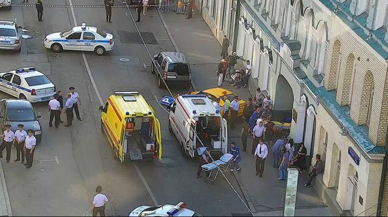 An ambulance and police work at the site of an incident after a taxi crashed into pedestrians on a sidewalk near Red Square in Moscow. (Photo: AP)