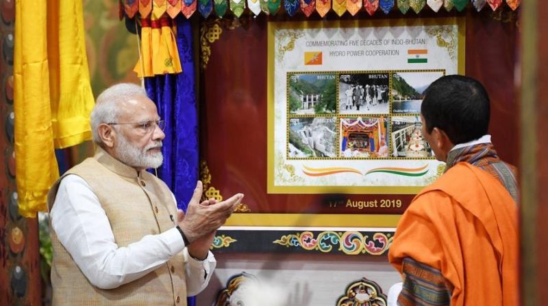 Stamps celebrating five decades of India-Bhutan hydropower cooperation were released by both Prime Ministers earlier this evening. Extensive cooperation in this sector has augured well for India as well as Bhutan. (Photo: Twitter | PMOIndia)
