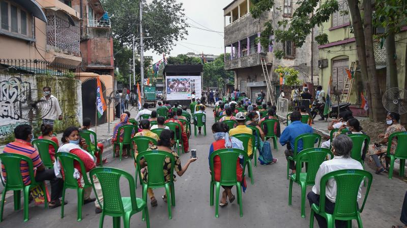 TMC workers maintain social distance while attending the virtual rally in Kolkata. (PTI)