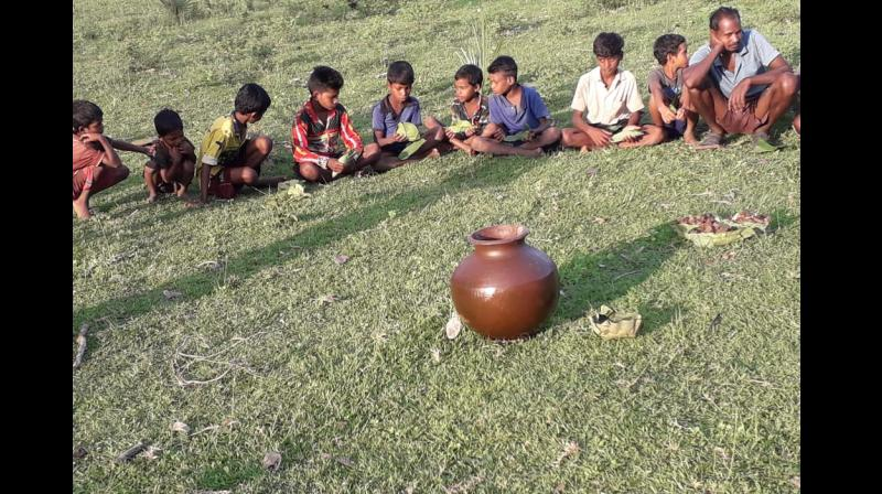 Children sit together to partake Salap.
