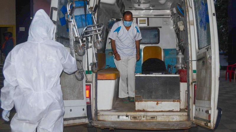 Ranchi: BJP MLA CP Singh steps out of an ambulance as he arrives at the Trauma Centre of Rajendra Institute of Medical Sciences (RIMS) after he was found positive with coronavirus, in Ranchi, Wednesday. (PTI)