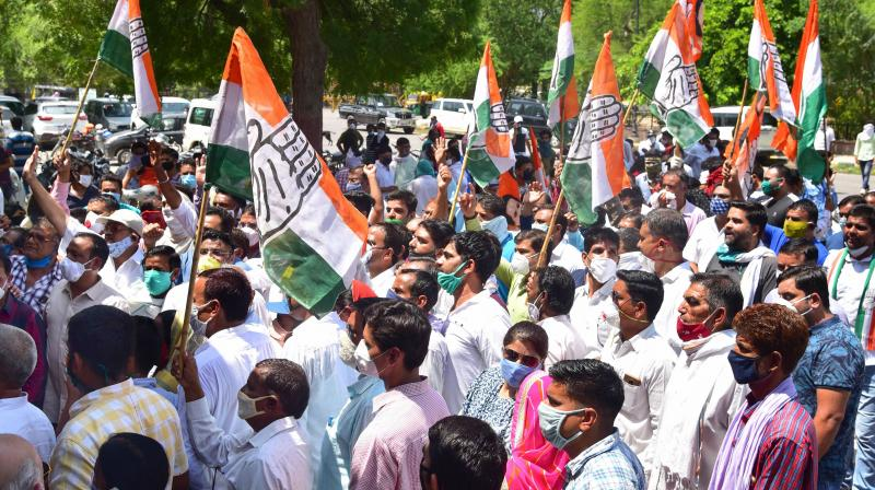 Bikaner: Congress activists stage a protest outside the collector office amid Rajasthan government crisis. (PTI)