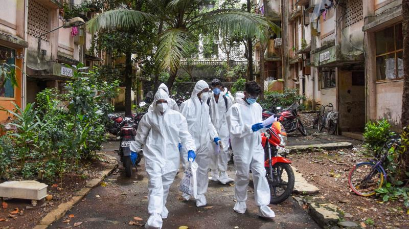 Mumbai: Health workers arrive to conduct door-to-door screening of residents of Dindoshi in the wake of coronavirus pandemic, at Goregaon East in Mumbai, Saturday. (PTI)