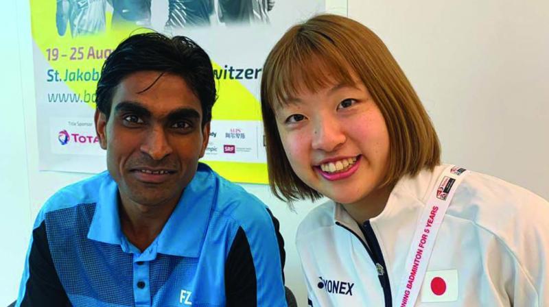 Para badminton star and world no. 1 Pramod Bhagat with Japanese world champion Nozomi Okuhara in Basel, ahead of the BWF World Championships.