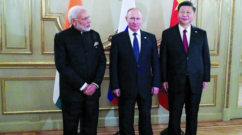 Prime Minister Narendra Modi with Russian President Vladimir Putin and China President Xi Jinping during a meeting in the sidelines of the G20 Summit in Buenos Aires. (Photo: AFP)