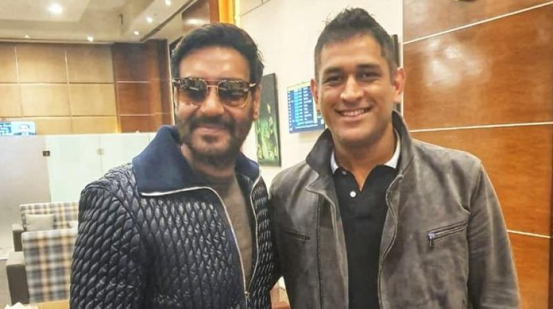 Ajay Devgn and MS Dhoni. (Photo: Twitter)