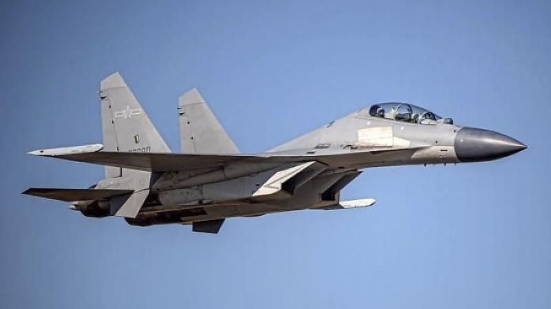 A Chinese PLA J-16 fighter jet flies in an undisclosed location. China sent a record 28 fighter jets, 14 of them J-16s, towards the self-ruled island of Taiwan on Tuesday, June 15, 2021, the island's defense ministry said, the largest such display of force since China started flying planes towards the island last year. (via AP)