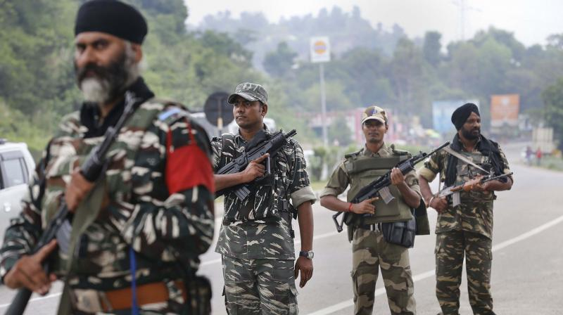 Security personnel patrol the Jammu-Srinagar national highway in Jammu on Friday. (Photo: PTI)
