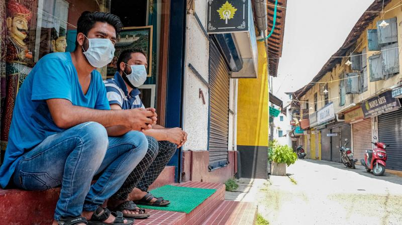 People wear masks in the wake of the coronavirus pandemic, in Kochi on March 21, 2020. (PTI)
