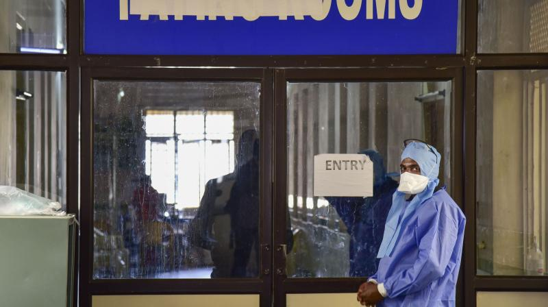 A medic stands at the isolation ward of Gandhi Hospital in Hyderabad. (PTI)
