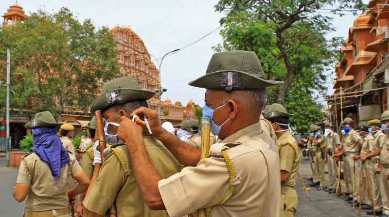 Police personnel mask up while preparing for a drill during the coronavirus lockdown in Jaipur on March 24, 2020. (PTI)