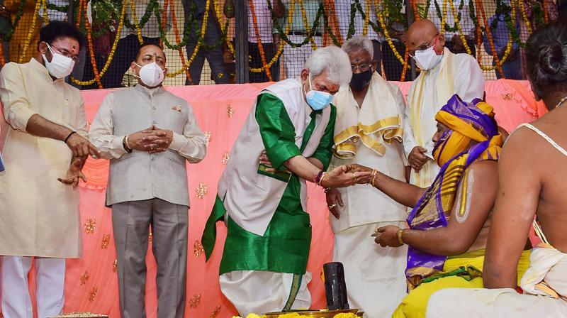 Lt Governor Manoj Sinha performs rituals during bhoomi pujan ceremony of Sri Venkateswara Swamy Temple by Tirumala Tirupati Devasthanams (TTD) at Majeen, Jammu. (PTI Photo)