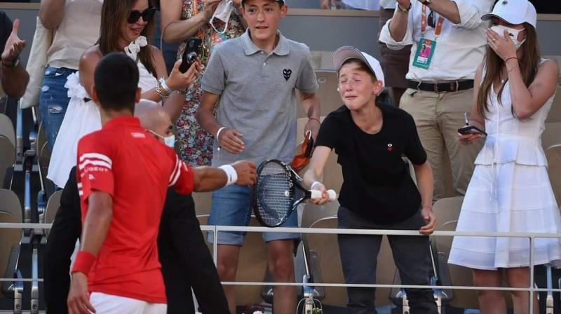 At the end of the four-hour and 11-minute final, Djokovic handed his racquet to the youngster who was then pictured on TV jumping for joy and in shock at the gesture. (Photo:Twitter)