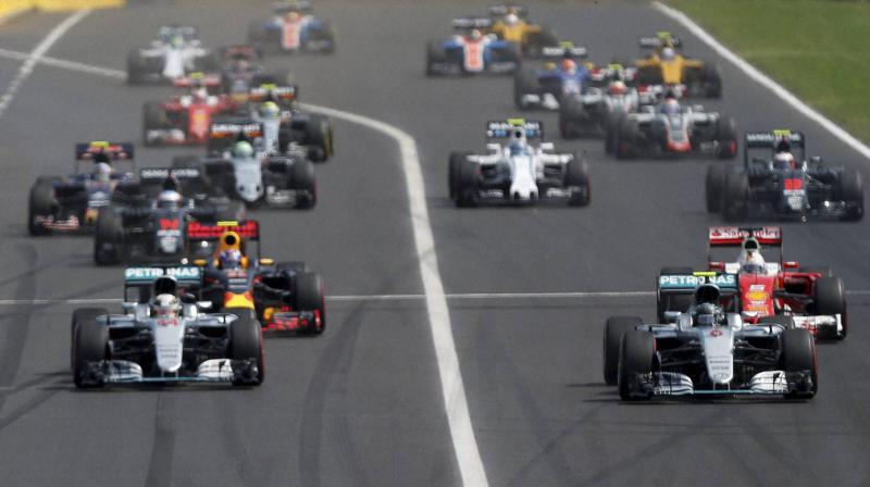 Mercedes driver Nico Rosberg of Germany (R) leads the start ahead of teammate Lewis Hamilton of Britain at the start of the Hungarian Formula One Grand Prix at the Hungaroring racetrack near Budapest, Hungary. AP Photo