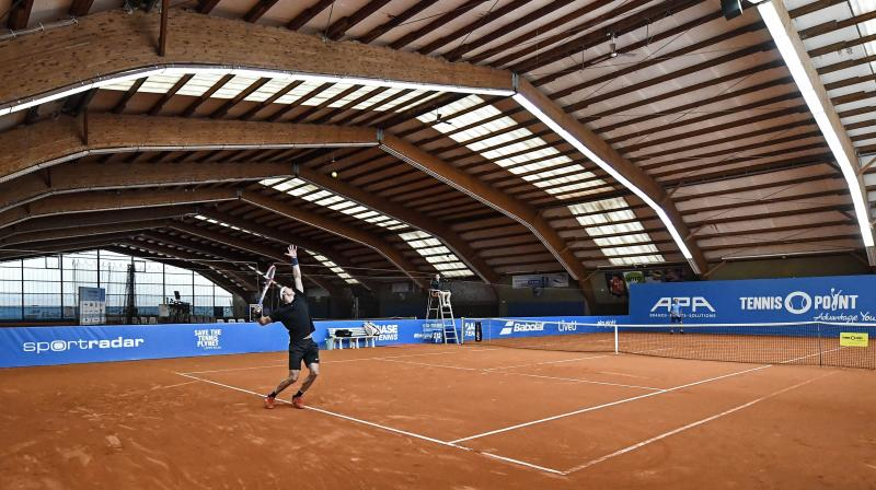 German tennis player Jan Choinski serves during an exhibition tournament at a local base tennis academy in Hoehr-Grenzhausen, western Germany. AP Photo