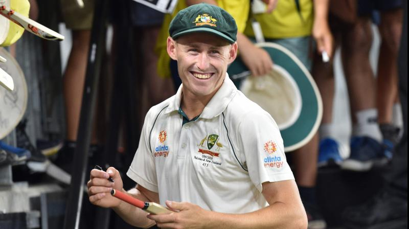 Australia's Marnus Labuschagne signs autographs for fans at the Perth Stadium. AFP Photo
