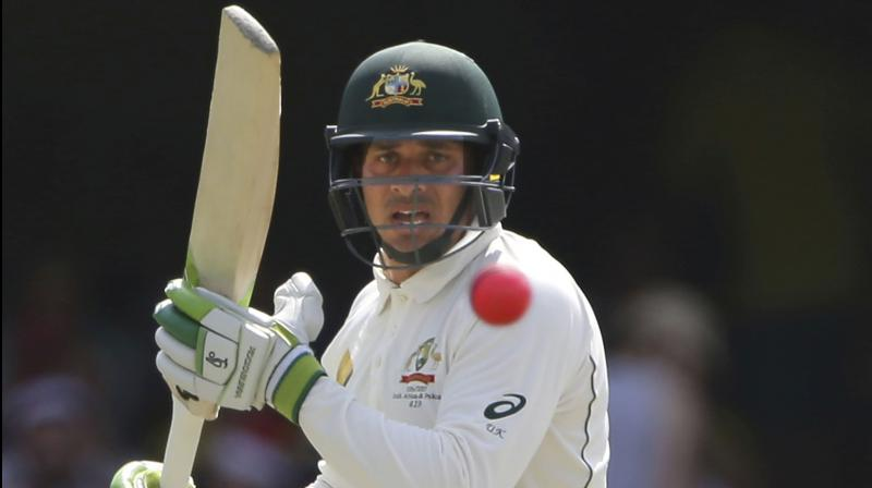 Australia's Usman Khawaja plays a shot during play on day three of the first cricket test between Australia and Pakistan in Brisbane, Australia. Australian cricketers have canceled a tour to South Africa in the first boycott of their ongoing pay dispute with the sport's national governing body. The Australian Cricketers' Association announced Thursday, July 6, 2017 that the Australia A tour will not go ahead. (AP Photo/Tertius Pickard, File)