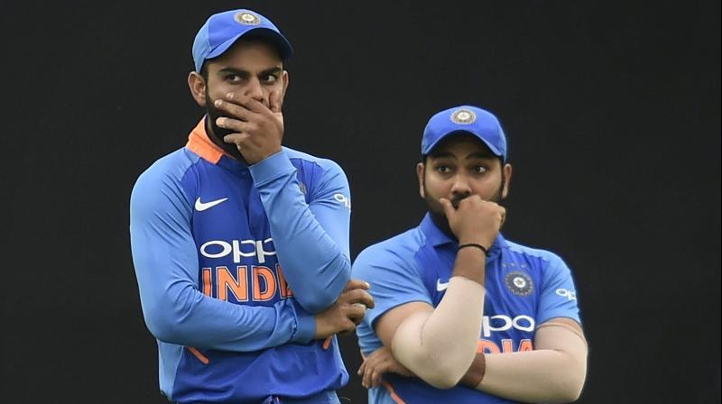 Virat Kohli and Rohit Sharma react to a spilled catch. PTI Photo