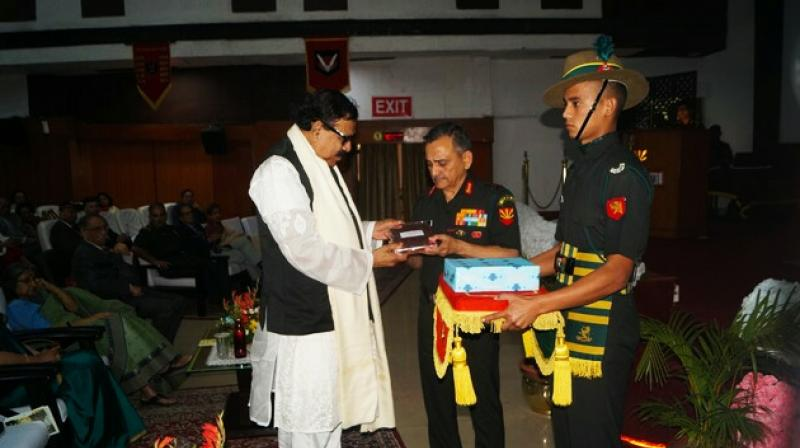 GOC-in-C (Eastern Command) Lt Gen Anil Chauhan hands over a memento to Bangladesh delegation leader and MP Shahjahan Khan during an event at Albert Ekka Auditorium in Fort William on Sunday.