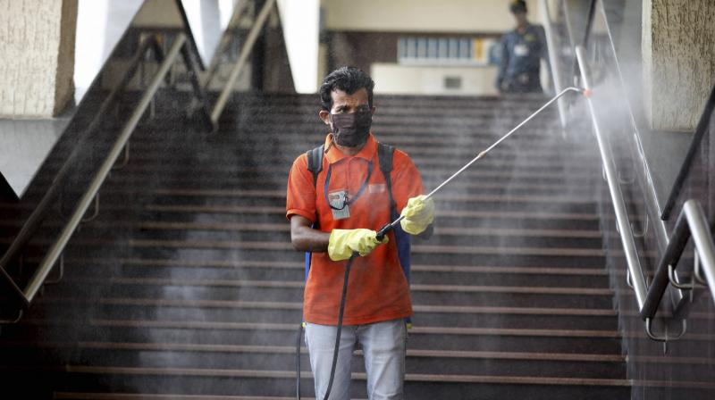 A municipal worker disinfects a metro station during ongoing COVID-19 lockdown, in Ahmedabad. PTI photo