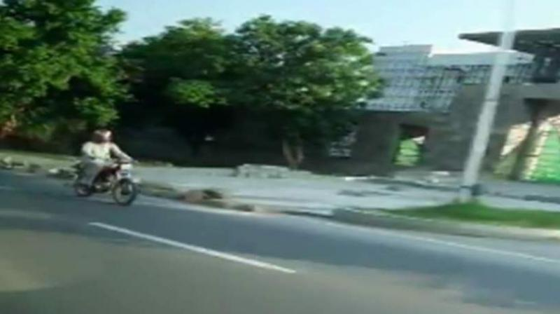 Screengrab of ISI agent chasing the vehicle of Indian diplomat in Pakistan (ANI)