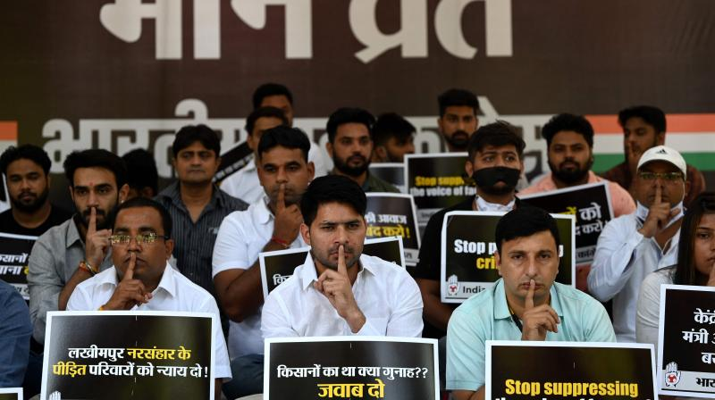 Activists of Youth Congress hold placards during a silent protest in New Delhi on October 11, 2021, days after at least eight people died in an incident involving protesting farmers in Lakhimpur Kheri. (Sajjad HUSSAIN / AFP)