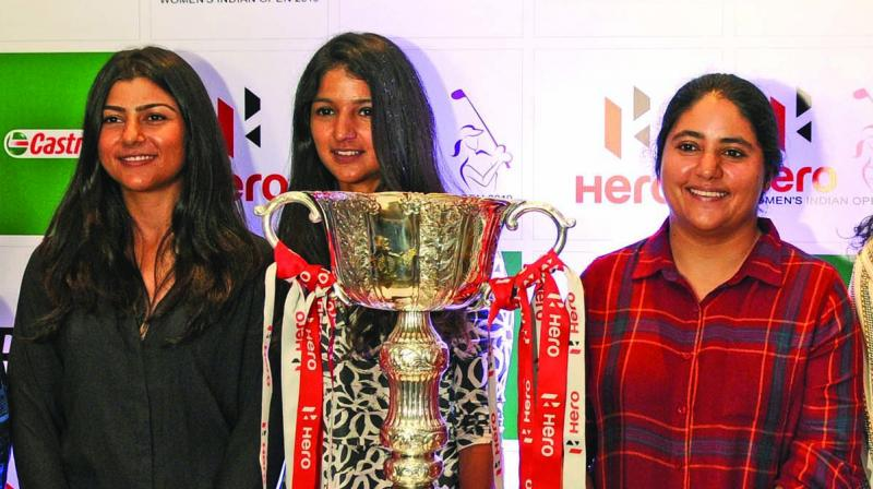 Indian golfers Tvesa Malik (from left) Neha Tripathi and Amandeep Drall pose with Indian Open trophy in New Delhi on Thursday. (Photo: BIPLAB BANERJEE)