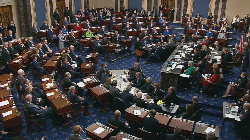This still image taken from a U.S. Senate webcast shows senators voting during the impeachment trial of U.S. president Donald Trump on February 5, 2020 in Washington, DC. The Senate acquitted Trump of both impeachment charges, following a historic two-week trial. (AFP PHOTO/ US SENATE TV)