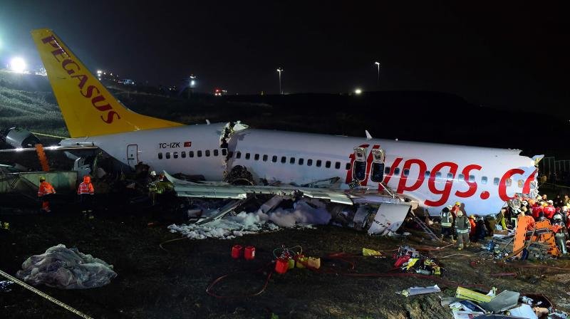 Rescuers work to extract passengers from the crash of a Pegasus Airlines Boeing 737 airplane after it skidded off the runway upon landing at Sabiha Gokcen airport in Istanbul on February 5, 2020. The plane carrying 171 passengers from the Aegean port city of Izmir split into three after landing in rough weather. Officials said no-one lost their lives in the accident, but dozens of people were injured. (AFP)