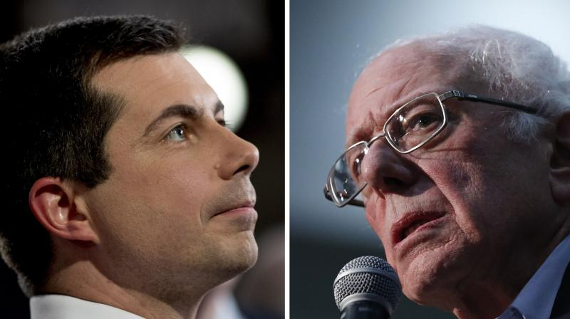 Democratic presidential candidates Pete Buttigieg (left) and Bernie Sanders remained locked in a tight race in the Iowa Democratic Party caucus. (AP)