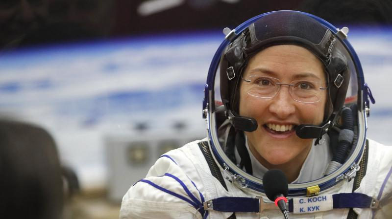 File photo of U.S. astronaut Christina Koch, member of the crew to the International Space Station (ISS), speaks with her relatives through a safety glass prior the launch of Soyuz MS-12 space ship at the Russian leased Baikonur cosmodrome, Kazakhstan. (AP)