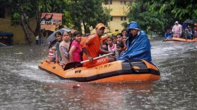 State Disaster Response Force (SDRF) workers rescue people from flood-affected area of Bahadurpur following heavy monsoon rainfall, in Patna. (Photo: PTI)