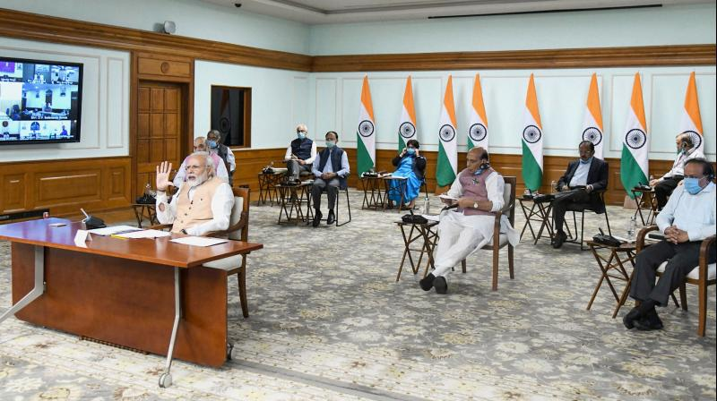 Prime minister Narendra Modi interacts with Union ministers on the COVID-19 crisis via video conference in New Delhi on Monday, April 6, 2020. (PIB/PTI Photo)